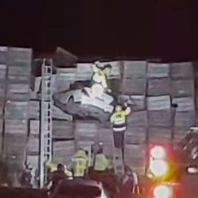 Car ends up lodged after crashing into crates, Hastings – video