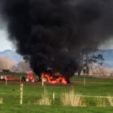Emergency Crews work to extinguish Tractor on Fire near Waitakaruru