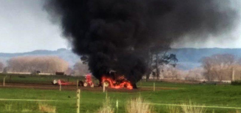 Emergency Crews work to extinguish Tractor on Fire near Waitakaruru